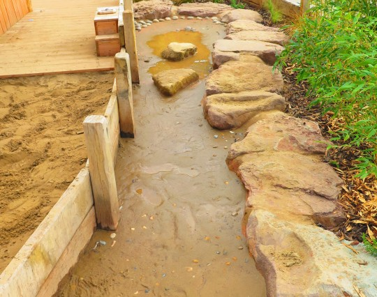 Dry river bed in school water play area