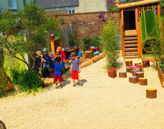 Nursery garden - natural playground - children playing in mud