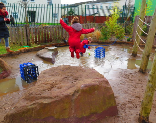 Playing in the rain - wellies - puddles